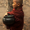 NOVICE ON HIS WAY FOR ALMS. KINPUN. KYAIKTO. MON STATE. BURMA. MYANMAR.