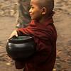 NOVICE ON HIS WAY FOR ALMS. KINPUN. KYAIKTO. MON STATE. BURMA. MYANMAR.