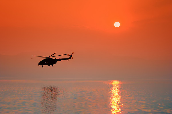 Chopper over Ohrid lake, at sunset