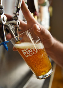 Co-owner Dylan Broome pours a glass of Southern Tier's Pumking at LD's Beer Run on Old Canton Road in northeast Jackson.