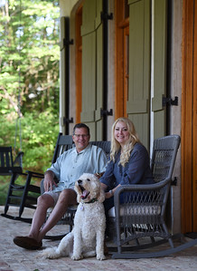 Marc and Wendy Koenisberger relax with their dog, Biscuit, on the front porch of their home in Lost Rabbit.
