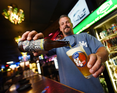 Owner Joseph Stodghill pours a glass of Live from New York brewery Southern Tier at Martin's Restaurant and Bar in Jackson.