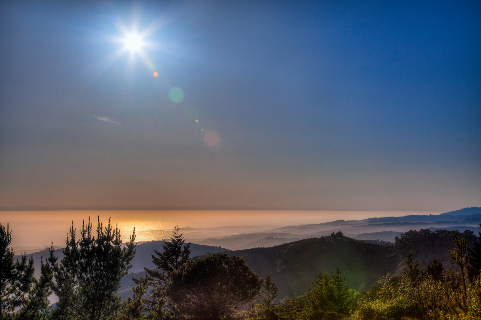 """This is looking to the west, nearing sunset, from the top of the mountains looking down onto Half Moon Bay. 37°27'41"""" N 122°20'45"""" W"""