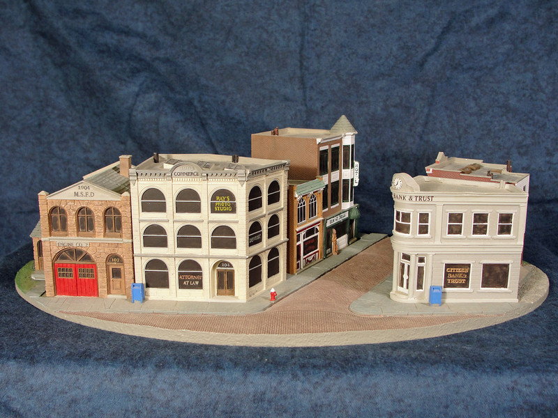 "Main Street, U.S.A. - Freelanced prototype.  Created this 12""X8"" slice of small town America as a possible collectible series.  It captures the character of turn of the century architecture in a set of six buildings displayed on a seperate base.  The original concept included citizens, vehicles, trees and lamposts that the collector could place themselves."