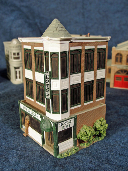 Close-up of Hotel Elms with Elm Street Drugs.