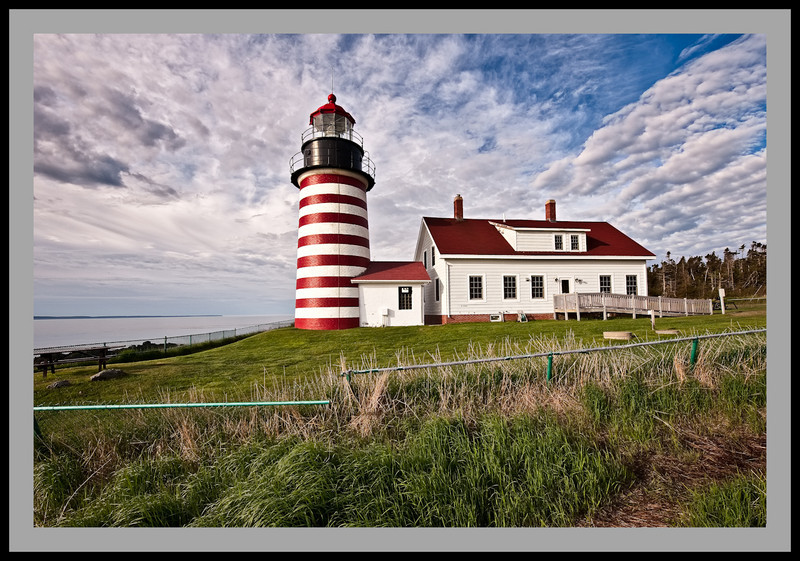 West Quoddy Lighthouse. Taken 1 hour after sunrise in early June 2009. Wide angle Nikon 14-24mm lens set at 14mm used.