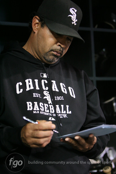 Chicago White Sox manager Ozzie Guillen (13) looks at his lineup options the baseball game between the Chicago White Sox versus Minnesota Twins at Target Field in Minneapolis, MN. The Twins won the game 5-4.