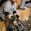 Chicago White Sox catcher A.J. Pierzynski (12) laces up his gear in late innings of the baseball game between the Chicago White Sox versus Minnesota Twins at Target Field in Minneapolis, MN. The Twins won the game 5-4.