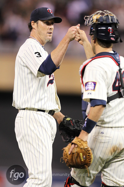 Minnesota Twins pitcher Joe Nathan (36) and catcher Drew Butera (41) celebrate the win of the Chicago White Sox versus Minnesota Twins baseball game at Target Field in Minneapolis, MN. The Twins won 5-4.