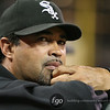Chicago White Sox manager Ozzie Guillen (13) views the baseball game between the Chicago White Sox versus Minnesota Twins at Target Field in Minneapolis, MN. The Twins won the game 5-4.