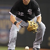 Chicago White Sox first baseman Paul Konerko (32) fields a grounder in the game against the Minnesota Twins at Target Field. The White Sox won the game 5-3.