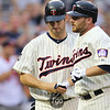 Minnesota Twins first baseman Joe Mauer (7) is batted in and greets right fielder Jason Kubel (16) for his first inning two-run blast in the game between the Chicago White Sox and the Minnesota Twins. The Twins went up 3-1 in the bottom of the first but fell to the White Sox 5-3.