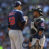 Cleveland Indians catcher Carlos Santana (41) and starting pitcher Jeanmar Gomez (58) have a conversation on the mound during the bottom of the fifth inning of a baseball game between the Cleveland Indians versus Minnesota Twins at Target Field in Minneapolis, MN. The Indians led 8-2 after the five innings and went on to win 10-4.