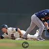 Minnesota Twins second baseman Brian Dinkelman (26) successfully steals second base before Jason Kipnis gains control in the bottom of the fourth inning of a baseball game between the Cleveland Indians versus Minnesota Twins at Target Field in Minneapolis, MN. The Indians led 8-1 after four innings and went on to win 10-4.