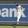 Minnesota Twins right fielder Joe Benson (63) sees a hit by Cleveland Indians designated hitter Travis Hafner in the top of the second inning of a baseball game between the Cleveland Indians versus Minnesota Twins at Target Field in Minneapolis, MN. The Indians led 8-0 after two innings and went on to win 10-4.
