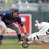 Minnesota Twins designated hitter Michael Cuddyer (5) is tagged out at second by Cleveland Indians short stop Asdrubal Cabrera (13) as he tried to stretch a single to a double in the bottom of the first inning of a baseball game between the Cleveland Indians versus Minnesota Twins at Target Field in Minneapolis, MN. The Indians led 2-0 after the first inning and went on to win 10-4.