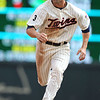 Minnesota Twins second baseman Brian Dinkelman (26) approaches third base in the bottom of the fourth inning of a baseball game between the Cleveland Indians versus Minnesota Twins at Target Field in Minneapolis, MN. The Indians led 8-1 after four innings and went on to win 10-4.