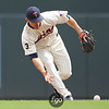 Minnesota Twins second baseman Brian Dinkelman (26) attempts to bare hand a grounder in the top of the fourth inning of a baseball game between the Cleveland Indians versus Minnesota Twins at Target Field in Minneapolis, MN. The Indians led 8-1 after four innings and went on to win 10-4.
