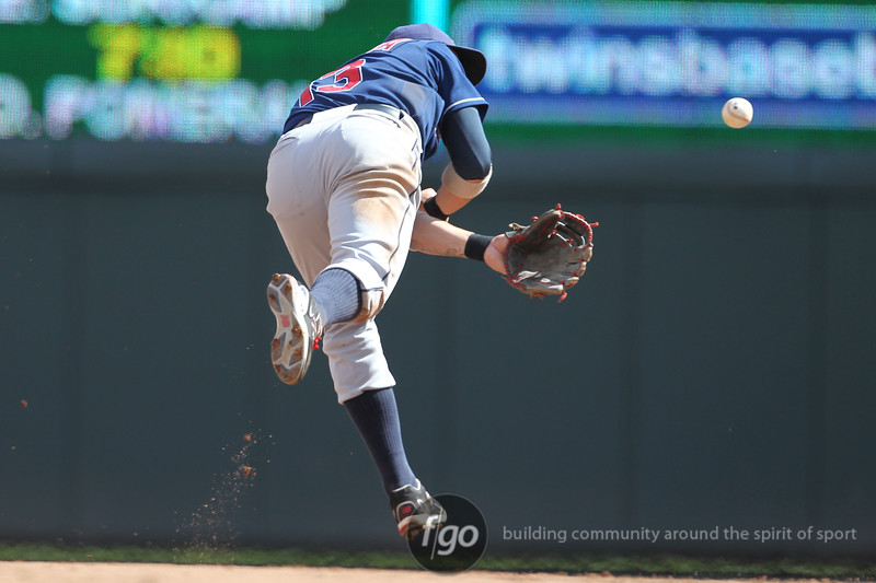 Cleveland Indians shortstop Asdrubal Cabrera (13) flips the ball back to second base for a putout in the bottom of the fifth inning of a baseball game between the Cleveland Indians versus Minnesota Twins at Target Field in Minneapolis, MN. The Indians led 8-2 after the five innings and went on to win 10-4.