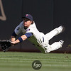 Minnesota Twins right fielder Joe Benson (63) stretches for a ball in the ninth inning of a baseball game between the Cleveland Indians versus Minnesota Twins at Target Field in Minneapolis, MN. The Indians won the game 10-4.