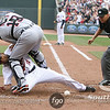 Minnesota Twins outfielder Ben Revere (11) beats out the tag by Detroit Tigers catcher Alex Avila (13) to tie the game at 7-7 in the bottom of the 8th inning. The Tigers won 0-7.