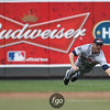 Detroit Tigers left fielder Ryan Raburn (25) dives for ball in the bottom of the second inning in a baseball game against the Minnesota Twins. The Tigers own the game 9-7.