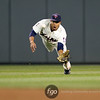 Minnesota Twins center fielder Ben Revere (11) dives to catch a fly ball by Alcides Escobar in the top of the sixth inning at the Kansas City Royals versus Minnesota Twins baseball game at Target Field in Minneapolis, MN. TThe game was tied 0-0 after six innings and the Twins won 1-0.