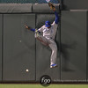 Kansas City Royals right fielder Lorenzo Cain (6) goes high off the wall after a Twins first baseman Chris Parmelee hit to lead off the bottom of the fourth inning at the Kansas City Royals versus Minnesota Twins baseball game at Target Field in Minneapolis, MN. The score was knotted at 0-0 after four innings and the Twins won 1-0 in the bottom of the ninth.