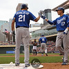 Kansas City Royals right fielder Jeff Francoeur (21) congratulates teammate second baseman Chris Getz (17)  crossing home plate in a 3-run 9th inning between the Minnesota Twins and the Kansas City Royals in Minneapolis, MN.  Royals win 10-5.