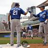 Kansas City Royals right fielder Jeff Francoeur (21) congratulates teammate second baseman Chris Getz (17)  crossing home plate in a 3-run 9th inning between the Minnesota Twins and the Kansas City Royals in Minneapolis, MN.  Royals win 10-5.