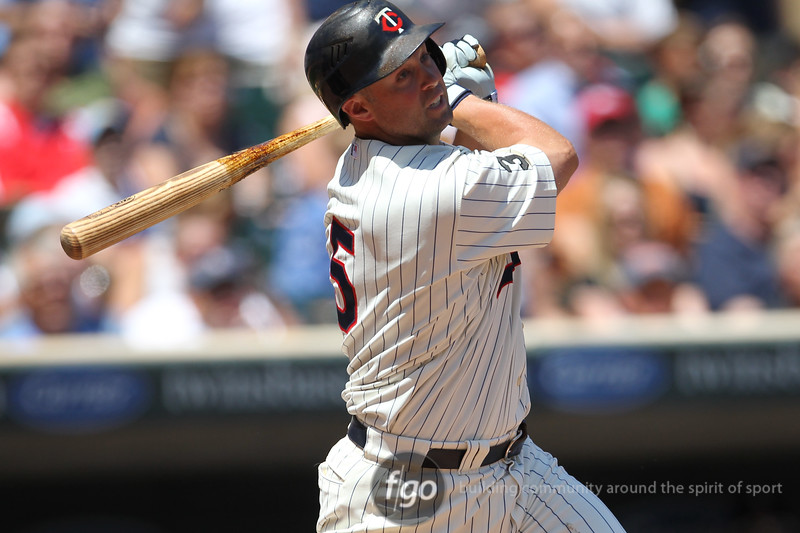Minnesota Twins right fielder Michael Cuddyer (5) gets a hit in the baseball game between the Los Angeles Dodgers versus Minnesota Twins baseball game at Target Field in Minneapolis, MN. The Twins won 1-0.