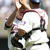 Minnesota Twins closing pitcher Matt Capps (43) and catcher Joe Mauer (7) celebrate the 1-0 victory in a baseball game between the Los Angeles Dodgers versus Minnesota Twins at Target Field in Minneapolis, MN. The Twins won 1-0.
