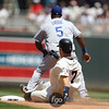 Minnesota Twins catcher Joe Mauer (7) slides into second in his double in the baseball game between the Los Angeles Dodgers versus Minnesota Twins baseball game at Target Field in Minneapolis, MN. The Twins won 1-0.