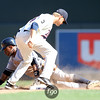 New York Yankees center fielder Trevor Granderson (14) steals second base in the ninth inning of the baseball game between the New York Yankees and Minnesota Twins. The Yankees won the game 3-0.