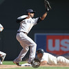 Minnesota Twins center fielder Ben Revere (11) safely reaches second base and beats the tag by New York Yankees shortstop Eduardo Nunez (26) in the bottom of the 8th inning of the baseball game between the New York Yankees and Minnesota Twins at Target Field. The Yankees won the game 3-0.