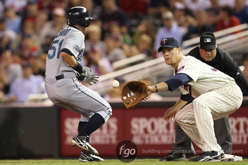 Seattle Mariners Ichiro Suzuki (51) returns to first base in a pick off throw in the eighth inning at the Seattle Mariners versus Minnesota Twins baseball game at Target Field in Minneapolis, MN. The Mariners won 8-7 in 10 innings.