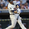 Minnesota Twins catcher Drew Butera (41) makes contact in the third inning at the Seattle Mariners versus Minnesota Twins baseball game at Target Field in Minneapolis, MN. The Twins team wore the #3 on their jerseys in memory of former Minnesota Twins Harmon Killebrew. The Mariners won 8-7 in 10 innings.