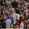Minnesota Twins fans try their hands at catching a foul ball at the Seattle Mariners versus Minnesota Twins baseball game at Target Field in Minneapolis, MN. The Mariners won 8-7 in 10 innings.