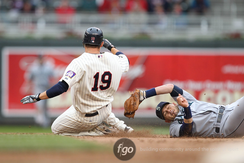 Minnesota Twins third baseman Danny Valencia (19) is thrown out in a steal attempt at second by Seattle Mariners shortstop Luis Rodriguez (1) in the bottom of the ninth inning at the Seattle Mariners versus Minnesota Twins baseball game at Target Field in Minneapolis, MN. Rodriguez left the game with an injury to the hand. The Minnesota Twins won the game 3-2 in the bottom of the ninth.