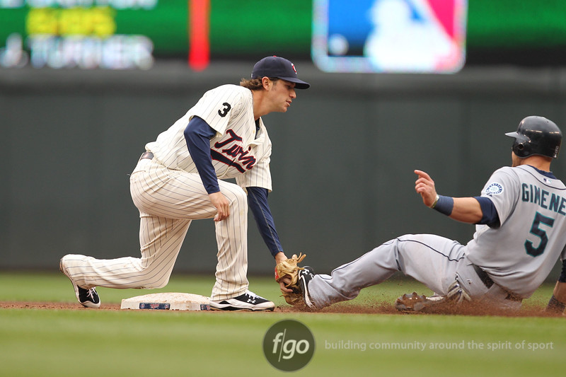 Seattle Mariners catcher Chris Gimenez is tagged out trying to steal at second base by Minnesota Twins second baseman Brian Dinkelman in the top of the fourth inning in a baseball game between Seattle Mariners versus Minnesota Twins at Target Field in Minneapolis, MN. The Mariners led 2-1 after top of the fourth The Minnesota Twins won the game 3-2.