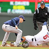 Tampa Bay shortstop Reid Brignac (15) tags out Minnesota Twins second baseman Michael Cuddyer (5) as he tries to stretch a double in the eighth inning in the baseball game between the Minnesota Twins and the Tampa Bay Rays in Minneapolis, MN.  Tampa Bay won 15-3.