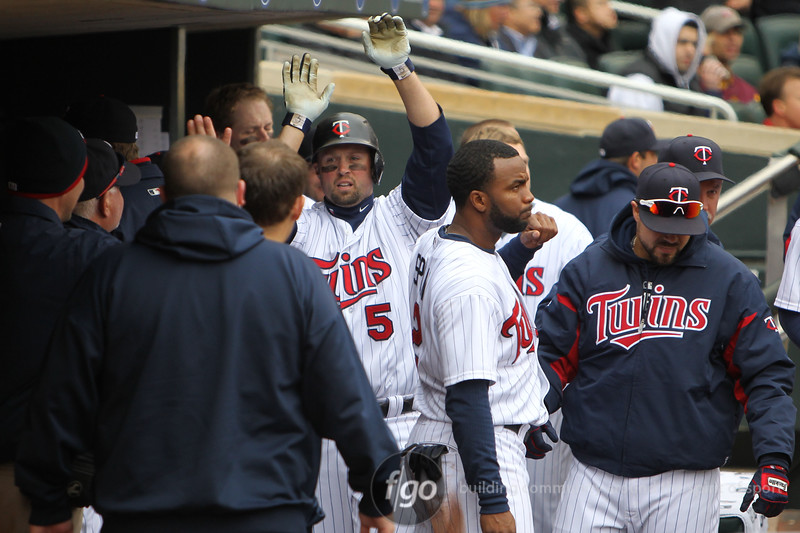 Minnesota Twins second baseman Michael Cuddyer (5) celebrates a home run with teammates in the seventh inning in the baseball game between the Minnesota Twins and the Tampa Bay Rays in Minneapolis, MN.  Tampa Bay won 15-3.