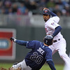 Minnesota Twins Alexi Casilla (12) puts out Tampa Bays Matt Joyce (20) in the third inning in the baseball game between the Minnesota Twins and the Tampa Bay Rays in Minneapolis, MN.  Tampa Bay won 15-3.