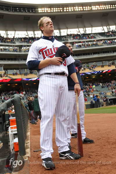 Minnesota Twins first baseman Justin Morneau (33) listens on during the playing of the national anthem prior to the baseball game between the Minnesota Twins and the Tampa Bay Rays in Minneapolis, MN.  Tampa Bay won 15-3.