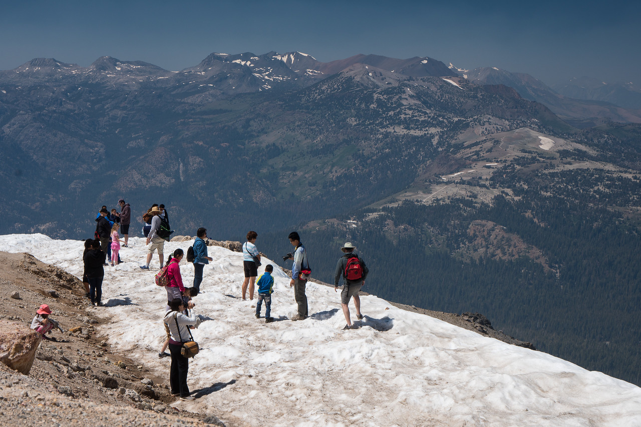 Snow and tourists on top of Mammoth Mountain