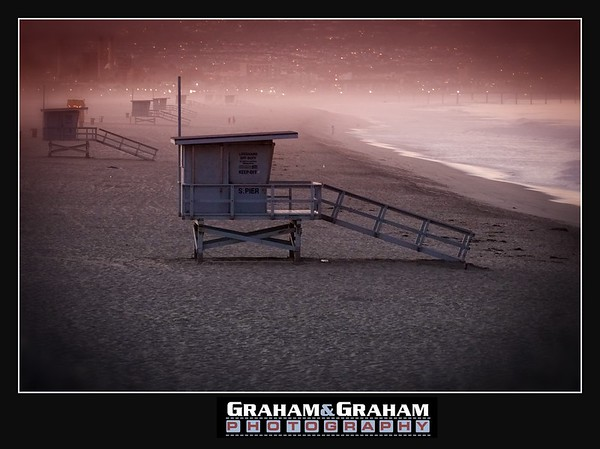Manhattan Beach Lifeguard stands at dawn