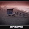 Manhattan Beach Lifeguard stands at dawn