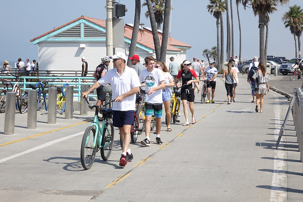 Walking bikes on the Manhattan Beach Strand