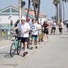 Walking bikes on the Manhattan Beach Strand