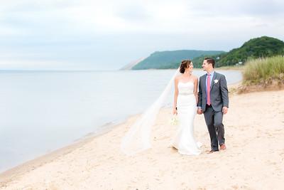 Empire MI Bride and Groom walking the Beach   Rayan Anastor Photography   Empire MI Wedding Photographer